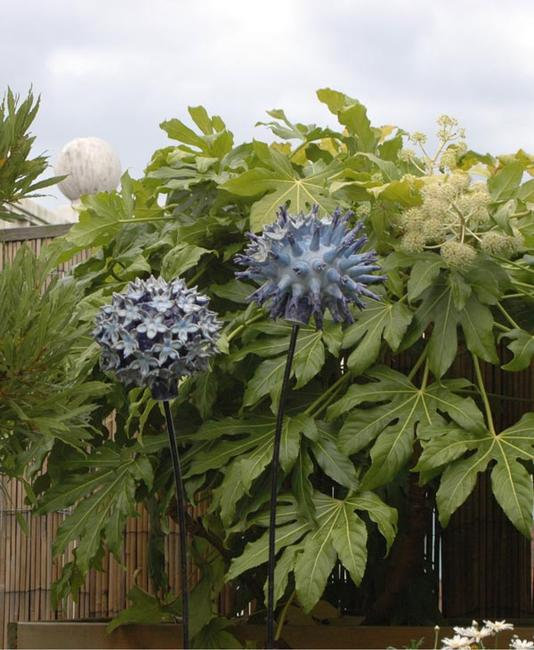 Globe Thistles on a roof terrace stoneware, wood and metal width=