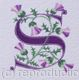 Letter S in purple with thistles.